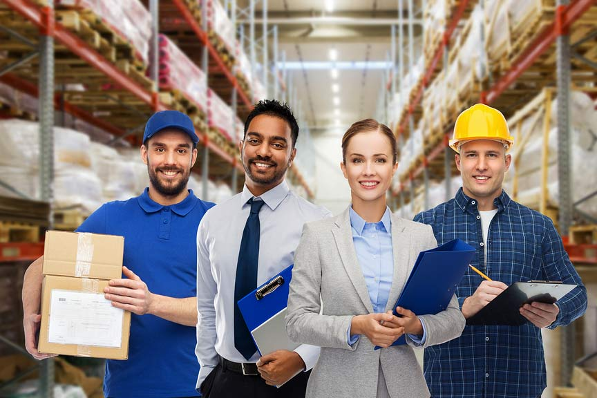 Four team members of a third party logistics shipping company in warehouse