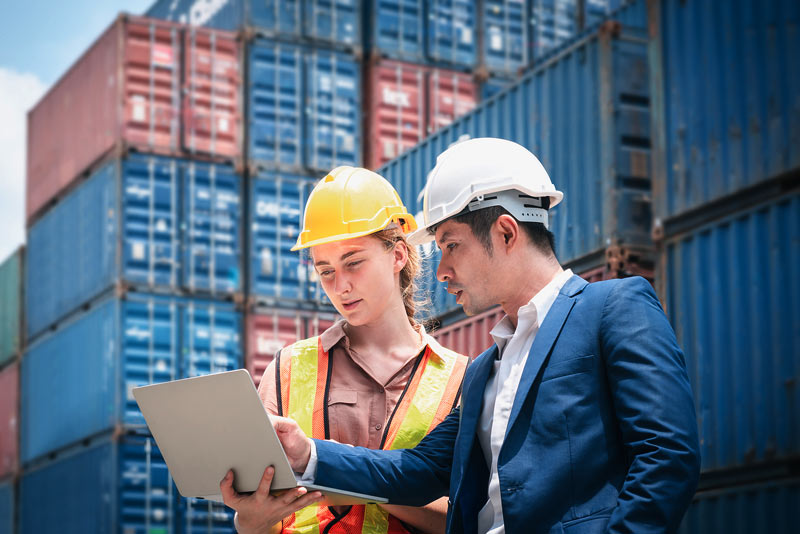Logistics man and woman in hard hats